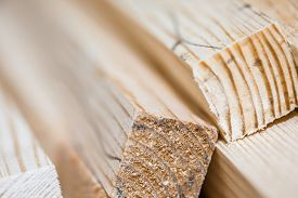 picture of lumber  - Wooden beams and planks. Lumber stacked at construction site ** Note: Shallow depth of field - JPG
