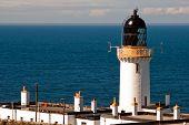 Lighthouse Against A Blue Sky