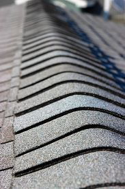 stock photo of shingles  - A close up view of a roof and shingles.