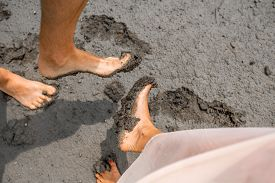 image of wet feet  - Couple showing feet smeared in the mud - JPG