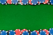 picture of roulette table  - Colorful gambling chips on green felt background with copy space - JPG