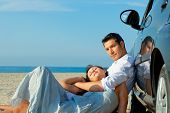 Beach sea coastline lying together masculine and feminine pair of to young adults driver loving embr