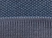 blue polo shirt fabric knit texture with sleeve section knit on top. high magnification.