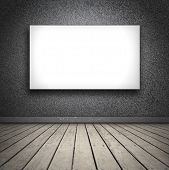 black room with wooden floor, with blank white board