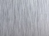 High resolution brushed metal. Vertical grain. Actual photo of brushed metal. Focus on entire surface.