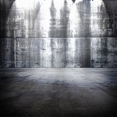 Huge concrete room with top light.