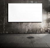 Dim stone room with white screen board.