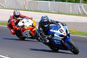 HUNGARORING, HUNGARY - JUNE 19: Two unidentified riders negotiate a corner during ROSBK event at Hun