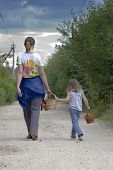 Mother And Daughter Are Walking Away