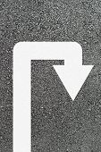 U-turn arrow on new asphalt