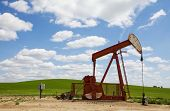 Oil field pump jack on the prairie