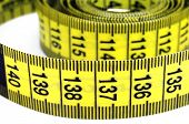 A partially coiled tape measure with the focus on the last few centimeters