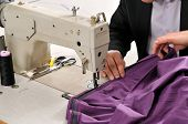 stock photo of tailoring  - Tailor using industrial sewing machine  - JPG