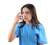 picture of asthma inhaler  - Teenager using inhaler for asthma isolated on white background - JPG