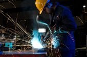 Worker making sparks while welding steel - a series of METAL INDUSTRY images.
