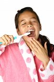 Young Girl Tired But Brushing Her Teeth At The Same Time