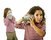 two girls talking on a tin phone isolated on white