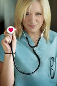 female nurse with stethoscope in her hand