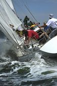 The men work with navigation of a yacht in the difficult storm sea. The present man's sports it yach