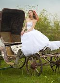 beautiful bride and old  carriage / retro style split toned