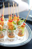 stock photo of sate  - Delicious chicken satay skewers served in a glass - JPG