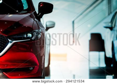 poster of Front View Of Red Car. New Luxury Compact Car Parked In Modern Showroom For Sale. Car Dealership Off
