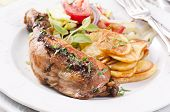 Chicken leg roasted with chips and salad