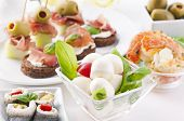 spanish tapas with caprese, canapes and seafood
