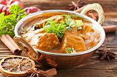Fish curry in copper bowl