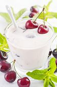 Fresh sweet cherry yoghurt in glass