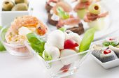 Antipasto with caprese, canapes and seafood