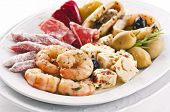 spanish tapas with seafood and sausages