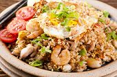 Nasi Goreng with fried egg, chicken and shrimps