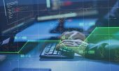 cybercrime, hacking and technology concept - hands of hacker in dark room writing code or using comp poster