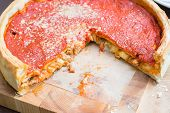 Top View Of Chicago Pizza. Chicago Style Deep Dish Italian Cheese Pizza With Tomato Sauce And Beef M poster