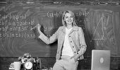 Teacher With Alarm Clock At Blackboard. Time. Woman In Classroom. Back To School. Teachers Day. Stud poster