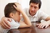 picture of sadness  - Father comforts a sad child - JPG