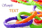 Brightly colored plastic chain links - a classic baby toy and teething ring also used to attach toys