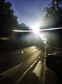 City Avenue Road With Direct Sunlight And Flare - Urban Concept And Inner City Street Under In Camer poster