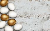 Gold And White Easter Eggs On Wooden Background. Rustic White Background. Colorful Golden Easter Egg poster