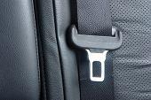 image of seatbelt  - Car seatbelt on the black leather seat - JPG