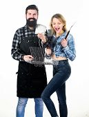 Joy Of Barbecue Style Of Cooking. Pretty Woman And Bearded Man Holding Cooking Grate. Happy Couple U poster