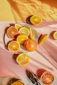 fresh exotic fruits on a vibrant color background. Conceptual still life in the morning, breakfast w poster