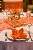 Orange Table Set For A Wedding Dinner