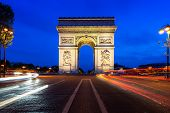 Paris Street At Night With The Arc De Triomphe In Paris, France. poster