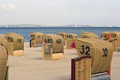 stock photo of labo  - Hooded beach chairs near Baltic Sea in Germany - JPG