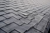 Close Up View On Asphalt Roofing Shingles Background. Roof Shingles - Roofing. Shingles Roof Damage  poster