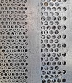 Rusty Stain On The Metal Plate. Metal With Holes. Background Metal Texture. poster