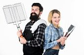 Couple In Love Hold Cooking Utensils Barbecue. Tools For Roasting Meat Outdoors. Picnic And Barbecue poster