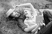 Couple In Love Spend Leisure Reading Book. Man And Girl Lay On Grass Relaxing. Romantic Couple Famil poster